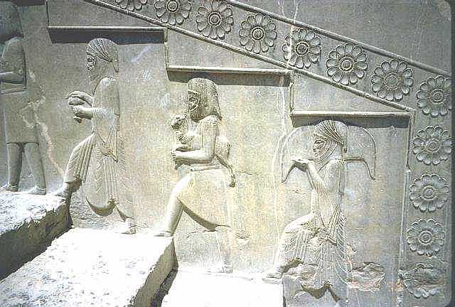 Stone relief carving from the Persian king's palace at Persepolis, showing subjects bringing tribute and gifts to the king (400s BC)