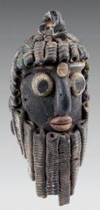 Phoenician glass - a face pendant of an African man. 400-200 BC