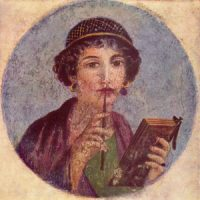 A woman from Roman Egypt, holding a notebook and a pen