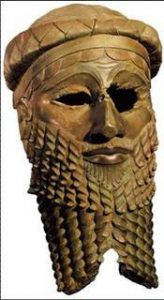 What is bronze? A man's head in bronze, with a beard: the metal is reddish-brown, the same as a penny