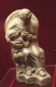 Small statue of a mother nursing her child (really a goddess)