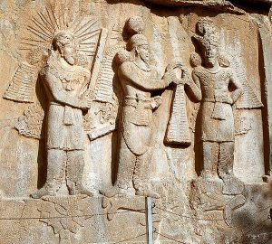 The Sassanid shah Shapur II hands power over to his general Ardashir II, while both of them trample on the defeated Julian.