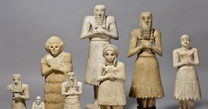 Sumerians - clay figures from Tell Asmar of little people with their arms folded in prayer