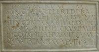 Claudia Pieris: portrait bust on her marble tombstone, dedicated by her husband Annius Telesphorus; inscription (CIL VI.15543). 117-138 CE. Copenhagen, Ny Carlsberg Glyptotek.