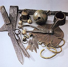 European trade goods including steel knives, bronxe bells, and bracelets