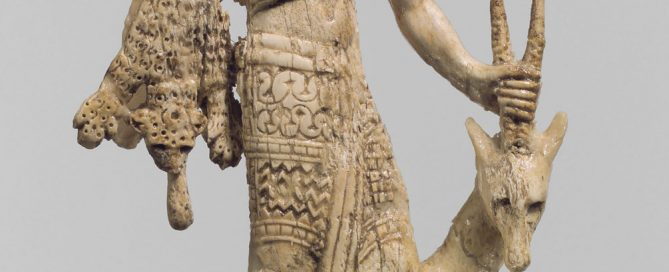 An Assyrian ivory from the 700s BC showing a Nubian man with an oryx, a monkey, and leopard skins, bringing them to the Assyrian king Assurnasirpal II