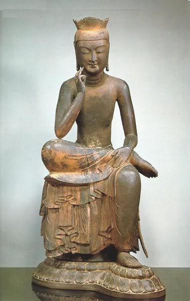 A statue of the Buddha thinking, from Silla (in Korea, about 900 AD)
