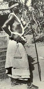 Black woman wearing raffia skirt