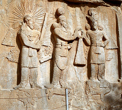 Ardeshir II gets his crown from the god Mithra and Shapur II, who are walking on the dead Roman emperor Julian