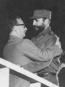 two hispanic men hugging