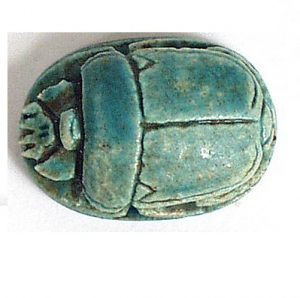 pale green-blue clay oval carved to look like a beetle