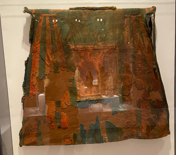 colorful old tunic in red and green and brown