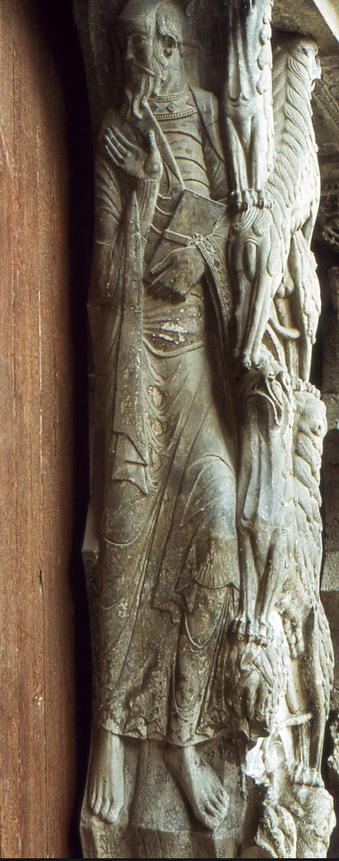 stone standing man in robes with slightly bent legs and big feet